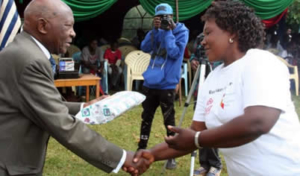 Joe Wanjui (seen at left presenting a gift to Nduta, one of the house mothers) picked up on Bishop Ranji's enthusiasm for science learning, announcing that his foundation will offer two full scholarships to girls who will be admitted to a university. No wonder he suggested they study hard.